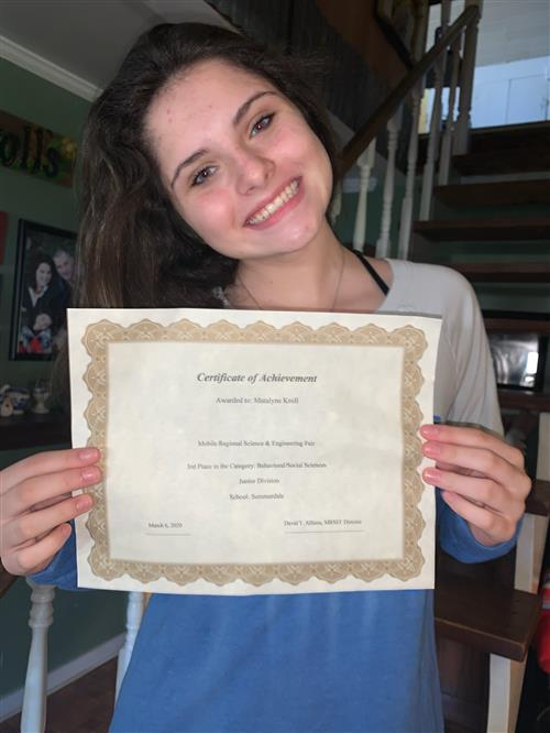 Matlyne Kroll with her certificate